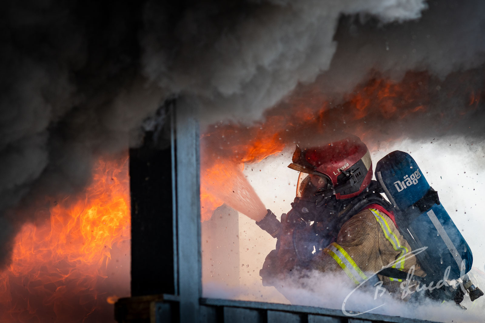 Firefighter controls flame
