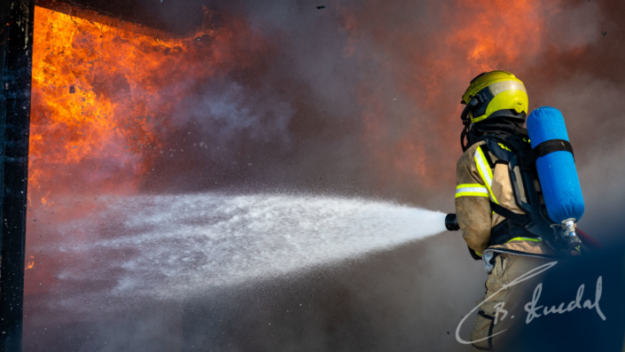 Firefighter against flame